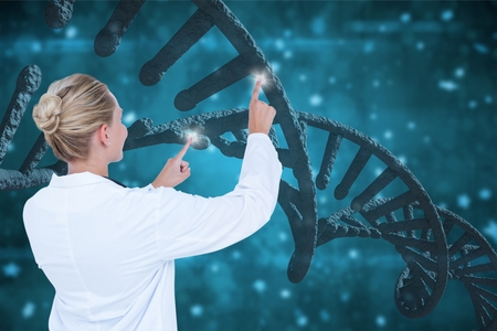 Digital composite of Doctor woman interacting with 3D DNA strands against blue background