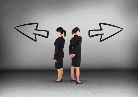 Digital composite of Left or right arrows with Businesswoman looking in opposite directions Stock Photo