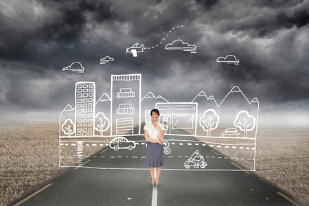 ominous: Digital composite of Business woman drawing a city on the road Stock Photo
