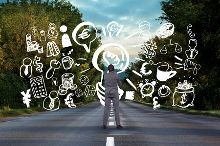 keywords adult: Digital composite of Business man drawing graphics  on the road