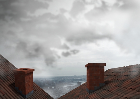Digital composite of Roofs with chimney and city clouds Stock Photo