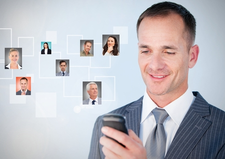 answering: Digital composite of Man holding phone with Profile portraits of people contacts Stock Photo