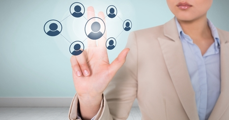Digital composite of Businesswoman interacting and choosing a person from group of people icons Stock Photo