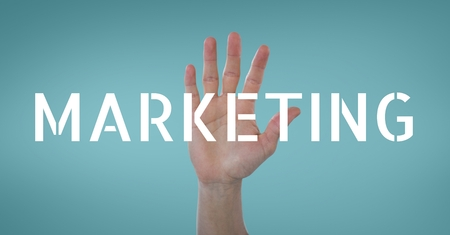 Digital composite of Hand interacting with marketing business text against blue background