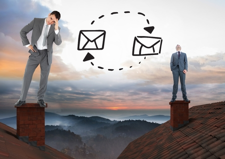 Digital composite of Email icons with Businessmen standing on Roofs with chimney and colorful landscape