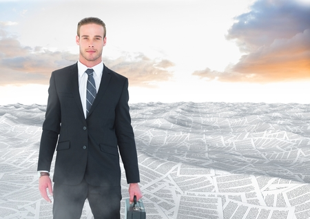 Digital composite of Businessman holding briefcase in sea of documents under sky clouds Stock Photo