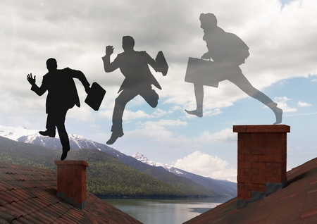 Digital composite of Businessman silhouettes with briefcase jumping on Roofs with chimney and mountain lake landscape