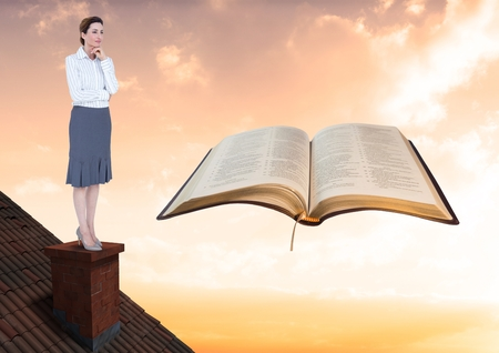 Digital composite of Woman on roof looking at book