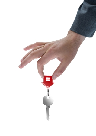 classy house: Digital composite of Business woman holding keys Stock Photo