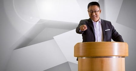 Digital composite of Businessman on podium speaking at conference with minimal background