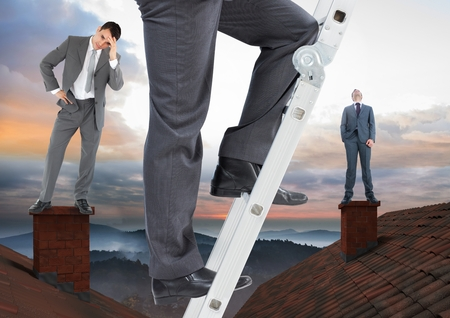 Digital composite of Businessman climbing ladder and Businessmen standing on Roofs with chimney and colorful landscape Stock Photo