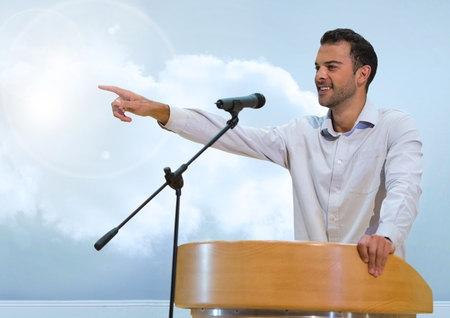 Digital composite of Businessman on podium speaking at conference with clouds