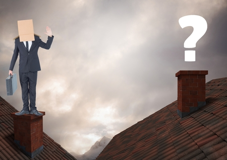 snowcapped mountain: Digital composite of Question mark and Businessman standing on Roofs with chimney and cardboard box on his head and drama
