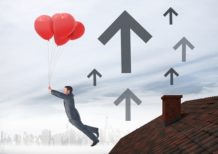 Digital composite of Up arrow icons and Businessman floating with balloons by Roof with chimney and foggy city
