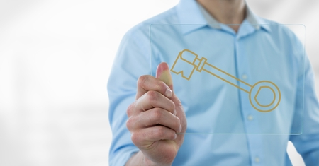 Digital composite of Business man holding a glass with keys icons Stock Photo