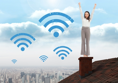 Digital composite of Wi-fi icons and Businesswoman standing on Roof with chimney and city