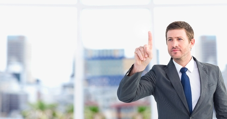 Digital composite of Businessman interacting with the air Stock Photo