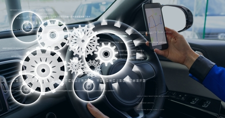 dashboard: Digital composite of Interface against person in the car