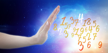 Hand of man pretending to touch invisible screen against digitally composite image of colorful lights Stock Photo