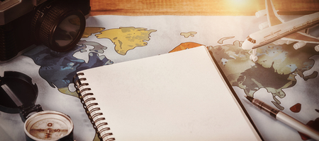 High angle viewof Diary by camera and toy airplane on map at table Stock Photo