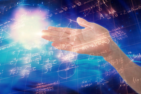 Cropped image of hand pretending to hold invisible object against image of geometric equations solved on blackboard
