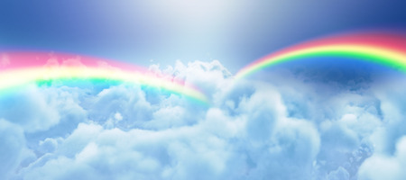 Graphic image of double rainbow against clouds against blue sky Stock Photo