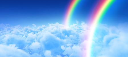 Digital image of rainbow against view of overcast against blue sky