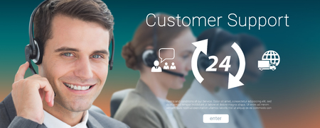 Business people with headsets using computers  against orange and turquoise background Stock Photo