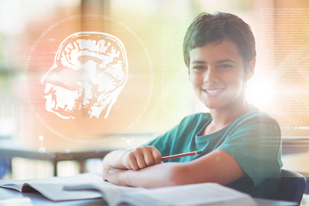Digitally image of DNA helix and brain interface against portrait of happy schoolboy studying in classroom