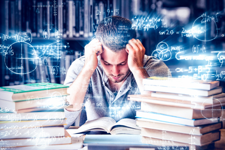 Tired student having lot to read in library Standard-Bild