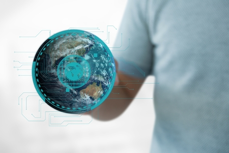 Digital composite of Business man holding a globe with connectors