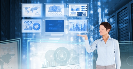 Digital composite of Businesswoman touching and interacting with technology interface panels Stock Photo