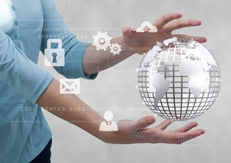 Digital composite of Business woman holding a globe with connectors Stock Photo