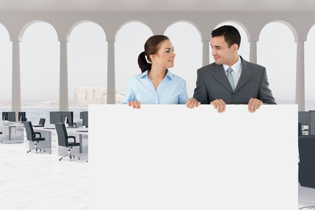 Digital composite of Business people holding blank card in office
