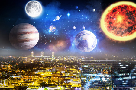 Composite image of solar system against white background against high angle view of illuminated crowded cityscape in 3d