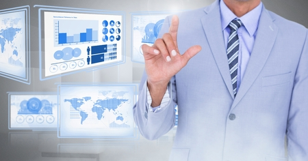 guy standing: Digital composite of Businessman touching and interacting with technology interface panels