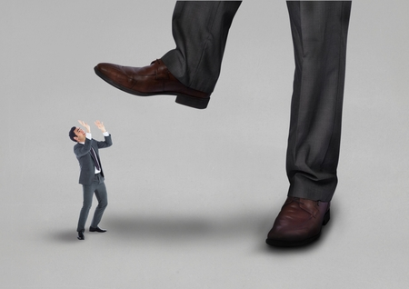 brogues: Digital composite of Scared small business man looking at a big business man Stock Photo