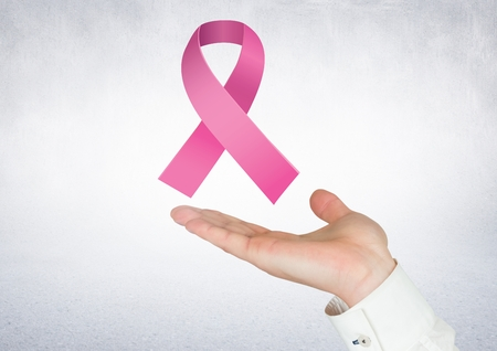 Digital composite of Open hand with pink ribbon for breast cancer awareness Stock Photo