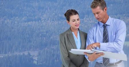 non: Digital composite of Business people in front of forest Stock Photo
