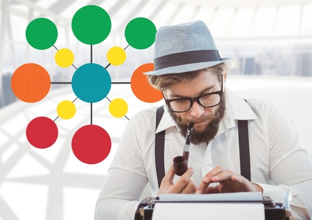 Digital composite of Hipster on typewriter with colorful mind map Stock Photo