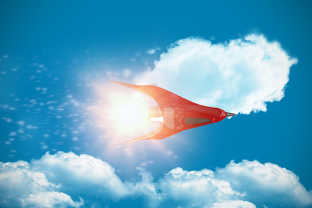 Red spaceship against white screen against royal blue Stock Photo
