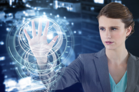 Businesswoman touching digital screen against multiple interface dial in blue background