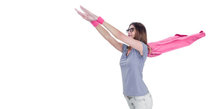 Woman in superhero costume pretending to fly on white background Stock Photo