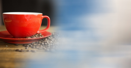 innumerable: Digital composite of Red coffee cup with beans and blurry sky transition Stock Photo