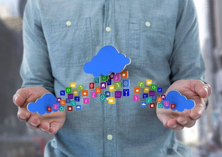 city background: Digital composite of hands with phone with application icons and cloud in each hand and other one in the middle panel ove