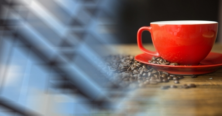 Digital composite of Red coffee cup with beans and blurry window transition