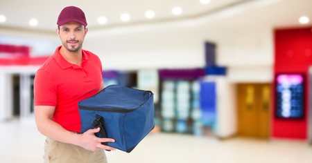 shopping binge: Digital composite of Delivery man against blurry shopping centre