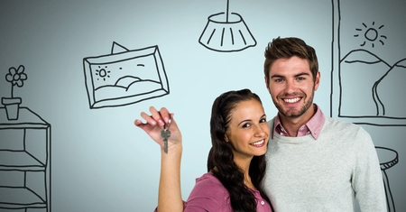 Digital composite of Couple Holding key with house home drawings in front of vignette Stock Photo