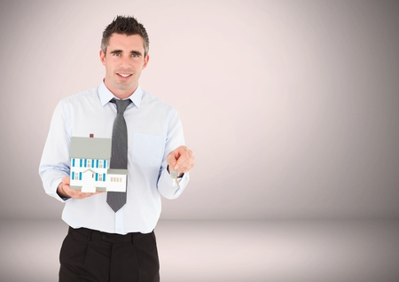 Digital composite of Man holding key in front of Vignette