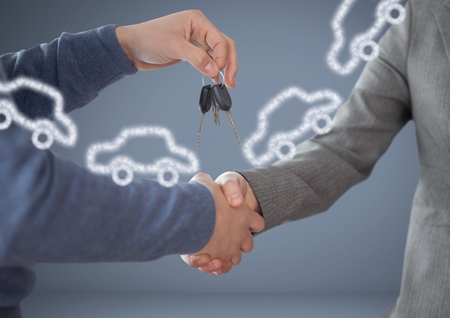 Digital composite of Hands Holding key with cars in front of vignette with handshake